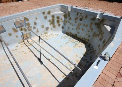 Swimming pool in bad condition, before renovation by Jadan Pool Renovations